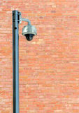 Security Camera against Brown Brick Wall Royalty Free Stock Images