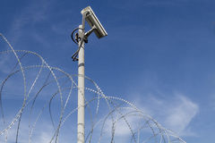 Security camera and barbed wire Royalty Free Stock Image