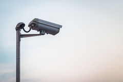 Security camera on blue sky Royalty Free Stock Image