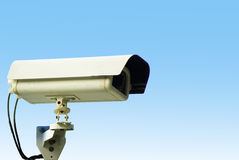 Security camera on blue sky background. CCTV security protective custody order Stock Images