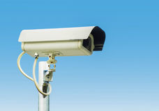 Security camera on blue sky background. CCTV security protective custody order Royalty Free Stock Photos