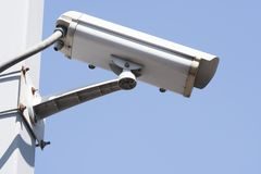 Security camera on blue sky background. Property protection Royalty Free Stock Photography