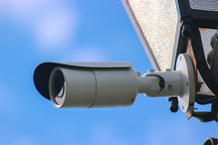 Security camera on a blue sky background stock image