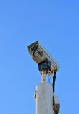 Cctv Security camera with blue sky stock photography