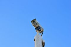 Cctv Security camera with blue sky royalty free stock photo