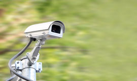 Security camera on blur green Royalty Free Stock Photos