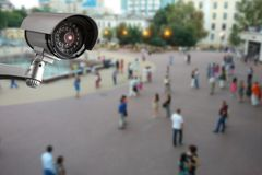 Security camera, blurry street with people on the background. Security CCTV camera, blurry street with people on the background closeup guard surveillance record royalty free stock photo