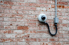 Security camera on the brick wall Royalty Free Stock Image