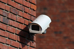Security  camera on brick wall facade Royalty Free Stock Photography