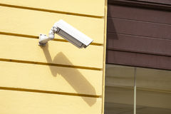 Security camera on a building wall. Royalty Free Stock Photos