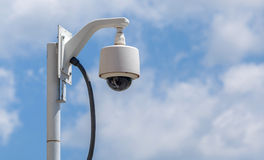 Security camera, CCTV on blue sky background. Security camera, CCTV is on blue sky background Royalty Free Stock Photos