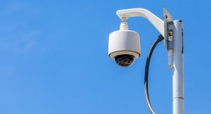 Security camera, CCTV on blue sky background. Security camera, CCTV is on the blue sky background Royalty Free Stock Photo