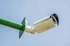 Security camera, CCTV on blue sky background. Stock Images
