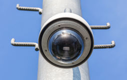 Security camera, CCTV on blue sky background Royalty Free Stock Photo