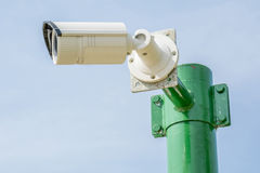Security camera, CCTV on blue sky background. Stock Image