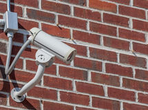 Security camera, CCTV on brick wall background Stock Images