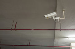 Security camera, CCTV camera in car park building. Royalty Free Stock Photo