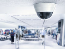 Security camera or cctv camera on ceiling. With retail shop background Stock Images