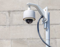 Security camera, CCTV in front of brick background Stock Images