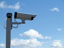Security camera cctv over blue sky Stock Photography