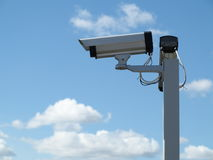 Security camera cctv over blue sky Stock Images
