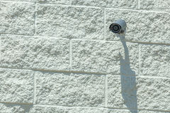 Security camera, CCTV on white brick wall. Stock Images