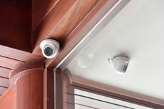 Security camera on the ceiling. CCTV security camera on the wooden ceiling Stock Photo
