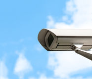 Security camera with cloudy sky in background Stock Photography