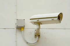 Security camera on concrete wall. CCTV Stock Photography