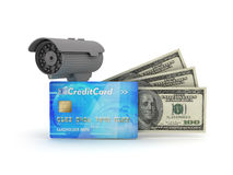 Security camera, credit card and dollar bills. On white background Stock Photos