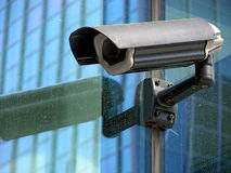 Security camera on the cristal wall. Facade Royalty Free Stock Photography