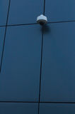 Security camera on dark modern building Stock Image