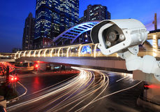 Security camera detects the movement of traffic. Skyscraper roof Royalty Free Stock Images