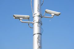 Security camera on high pole with blue sky Royalty Free Stock Photos