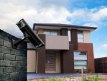 Security camera with house Royalty Free Stock Photography