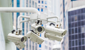 Security Camera in a Modern Building background. Stock Image