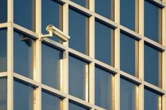 Security camera on a modern building facade stock image