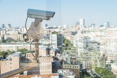 Security camera monitor the movement. Of the top of the building Royalty Free Stock Image