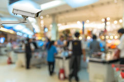 Security camera monitoring the cashier store blur with bokeh bac Stock Photography