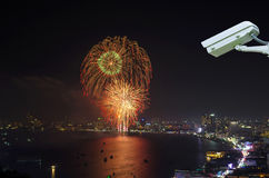 Security camera monitoring the multicolor fireworks night scene Royalty Free Stock Photography
