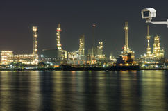 Security camera monitoring the Oil and gas refinery at night tim Royalty Free Stock Photography