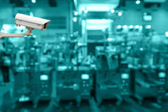 Security camera monitoring the store blur background with bokeh Royalty Free Stock Image