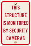 A security camera monitoring street sign Stock Photo