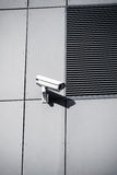 Security camera on office building wall Stock Images
