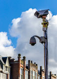 Security camera in the old street. Security camera placed in old residential area of The Hague Royalty Free Stock Photo