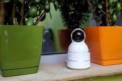 Funny surveillance camera in the form of a robot Stock Photo