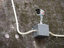 Security camera. Over aluminum box Royalty Free Stock Photo