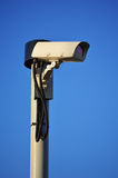 Security camera over blue sky Stock Image