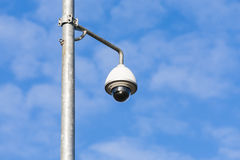 Security camera on a pole. Royalty Free Stock Photo