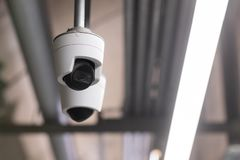 Security camera in the public park city